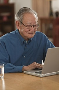 Man updating Facebook