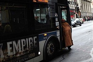 Women getting on a city bus
