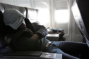 Man asleep on an airplane