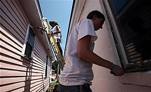Man working on outside of home