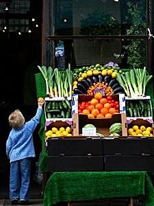 Kid getting veggies