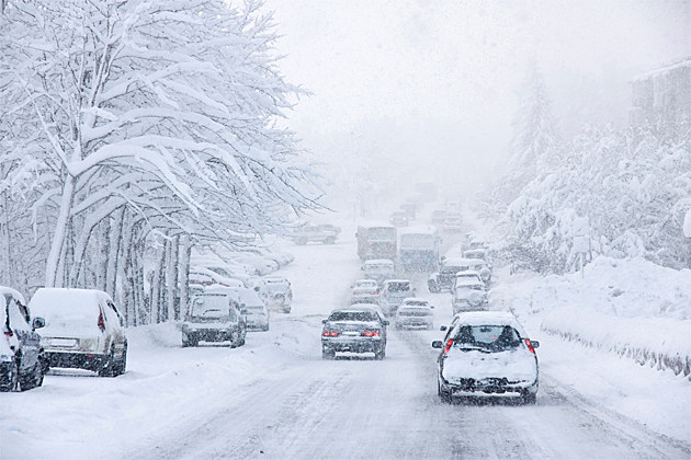 Snowing on Cars - iStock